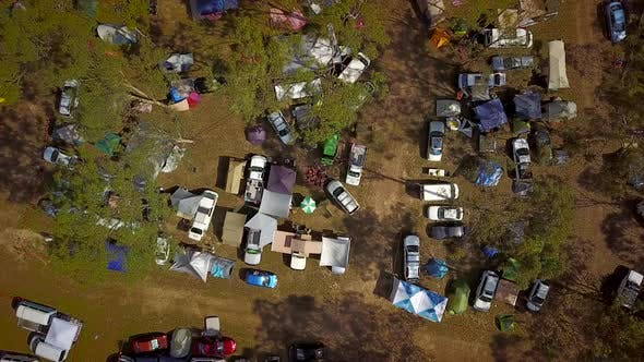 Thumbnail for Aerial view of campers and tents at festival.