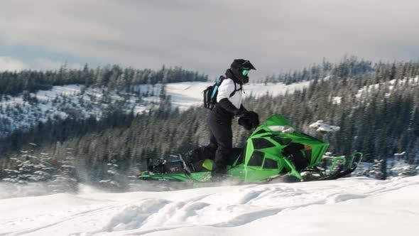 Thumbnail for Snowmobile Athlete Profile Riding In Snowy Mountains Slow Motion