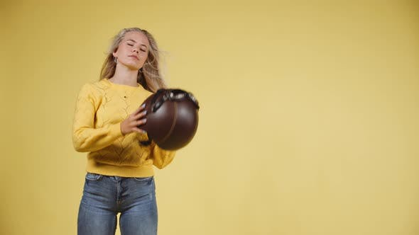 Thumbnail for Young Model Removing Her Helmet While Wagging Her Long Blonde Hair