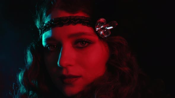 Cover Image for Old-fashioned Woman Dressed in Style of Gatsby Posing on Background with Neon