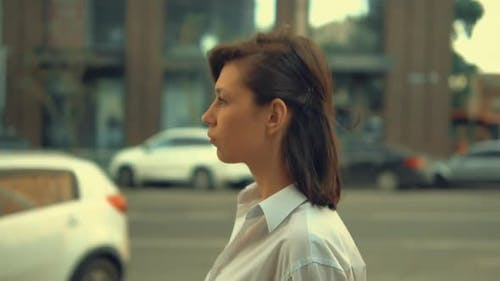 Adult Woman Walks in City