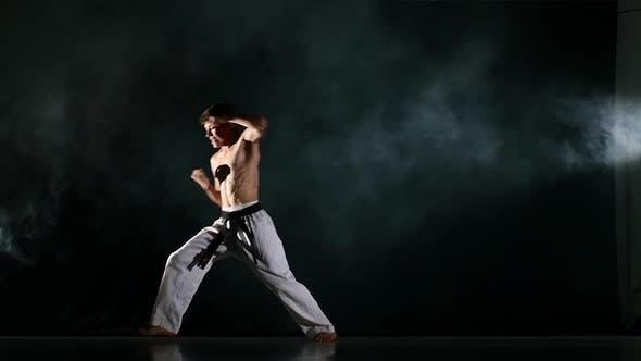 Thumbnail for Man Training Taekwondo or Karate Isolated on Black Background. Slow Motion