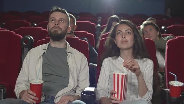People Watching Movie in Cinema