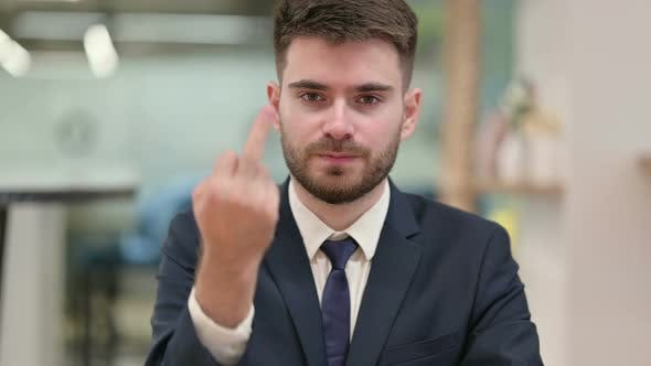 Angry Young Businessman Showing Middle Finger