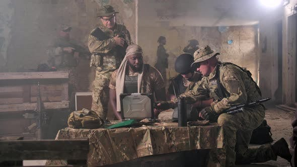Thumbnail for Soldiers Discussing Military Operation at Laptop