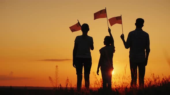 Thumbnail for Family with Child Waving US Flags at Sunset, Rear View