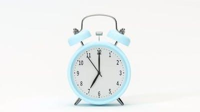 Classic alarm clock, alarming at 7 o 'clock.