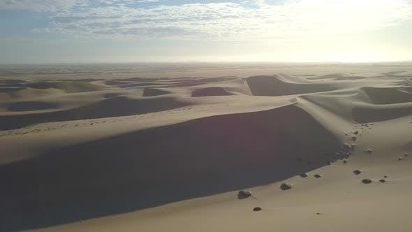 Aerial drone view of sand dunes sanddunes safari in Africa desert.