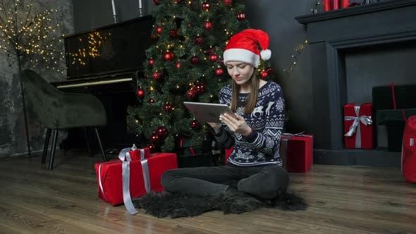 Cute Teen Girl Using Tablet Near Christmas Tree Christmas Eve Online Shopping