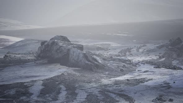Antarctic Mountains with Snow in Fog