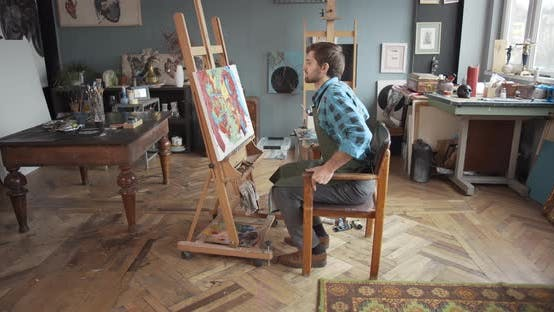 Thumbnail for Male Artist Working in Studio