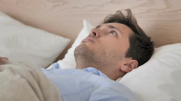 Thumbnail for Uncomfortable Man Waking up from Sleep in Bed