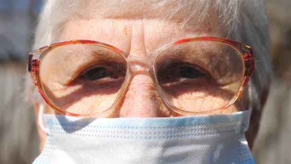 Thumbnail for Detail Portrait of Granny in Protective Mask From Virus. Elderly Woman Looking Into Camera with