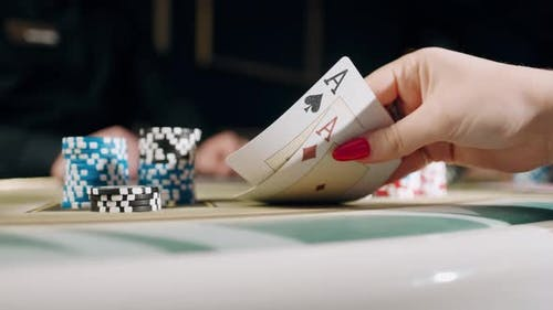 People Playing Poker in Casino. Two Aces