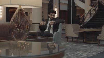 Businessman Waiting in Lobby