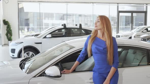 Thumbnail for Sexy Beautiful Woman Smiling To the Camera Standing Near New Car at Dealership