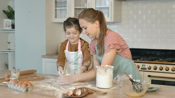Thumbnail for Girl and Mother Make Pile with Flour Cooking Cake at Table