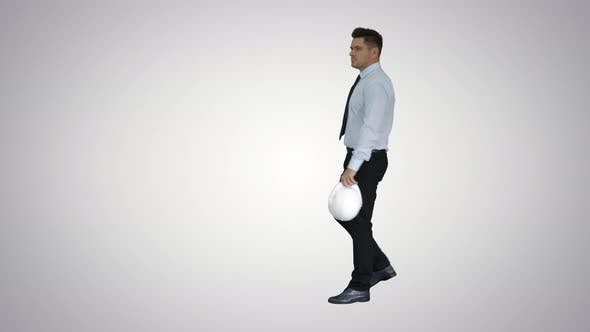 Thumbnail for Businessman Putting Hardhat Helmet on Safety on Gradient Background.
