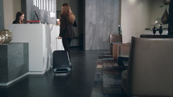 Thumbnail for Business Woman with Travel Suitcase Arriving in Hotel at Vacation