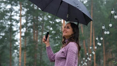 Woman with Umbrella Lending Hand for the Rain