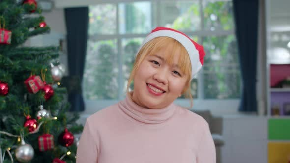 Female teen wear Christmas hat relax happy smiling looking at camera enjoy xmas winter holidays.