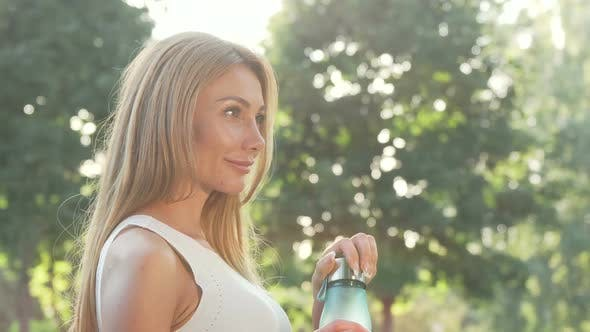 Cover Image for Beautiful Woman Enjoying Drinking Water After Outdoor Workout