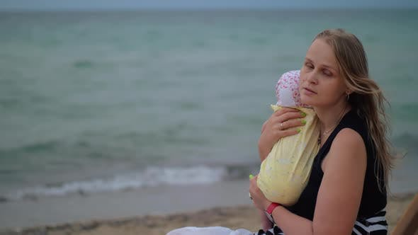 Thumbnail for Sad Mum with Baby Near the Sea