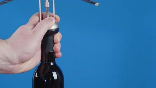 Men's Hands Corkscrew Open a Bottle of Wine.