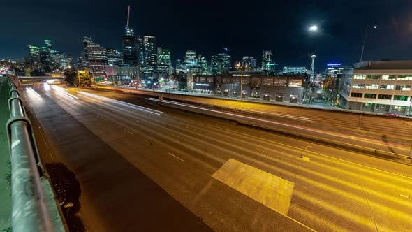 Thumbnail for Wide City Night Timelapse With Glowing Street Lights And Freeway Car Streaks