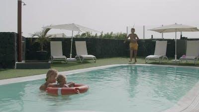 Performing his best pool jump