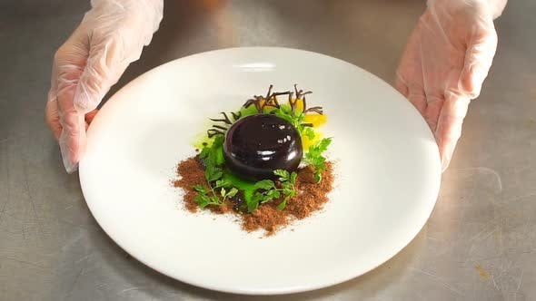 Thumbnail for Hands of Chef Preparing Salad in Restaurant.