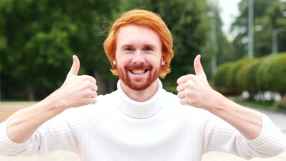 Thumbnail for Thumbs Up with Both Hands by Man with Red Hairs, Outdoor