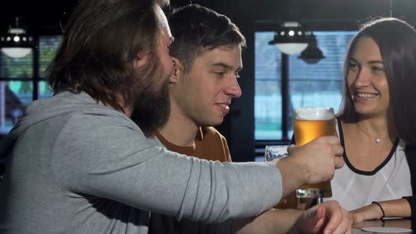 Thumbnail for Bearded Man Enjoying Beer with His Friends at the Bar