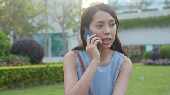 Woman look at the cellphone in park