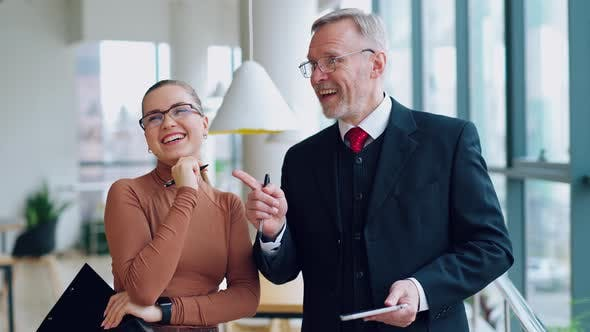 Smiling colleagues talking in the office