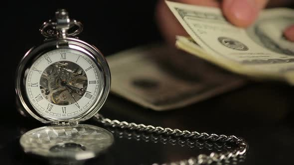 Thumbnail for Hands Counting Money, Person Calculating Savings, Time Flies on Pocket Watch
