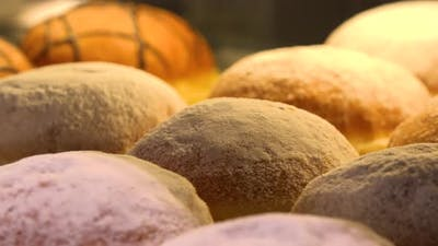 Closeup on Berliner Doughnuts on Display on a Glass Shelf in a Bakery