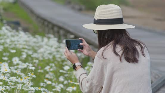 Thumbnail for Woman take photo with cellphone in countryside