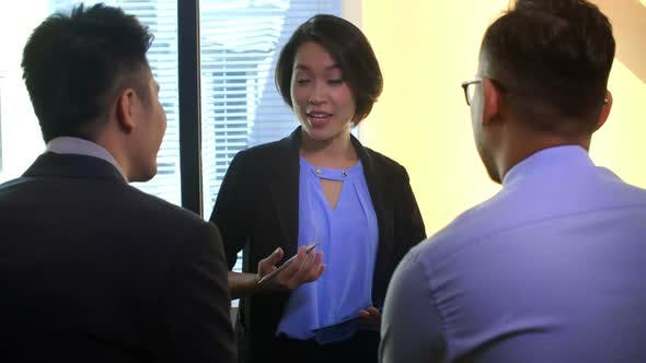 Thumbnail for Asian Businesswoman Consulting Colleagues