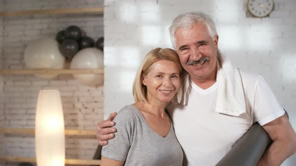 Thumbnail for Happy Mature Caucasian Owner Couple Posing in Their Yoga Studio