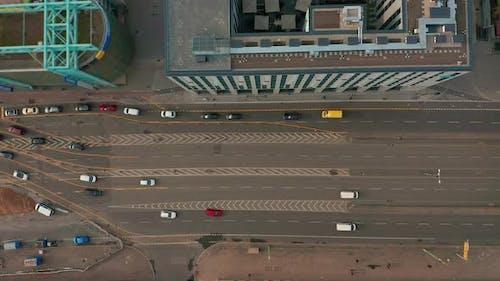 Aerial View. Multilane Road with Arrow Symbol. Urban Cars Speeding on Road