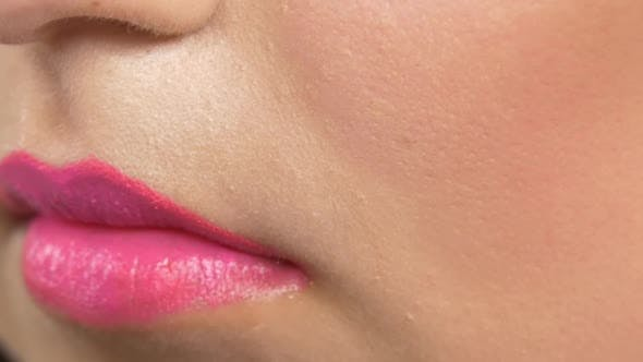 Thumbnail for Make-up Artist Using Brush and Making Blusher on Her Cheeks, Cam Moves From Lips To Cheek, Close Up