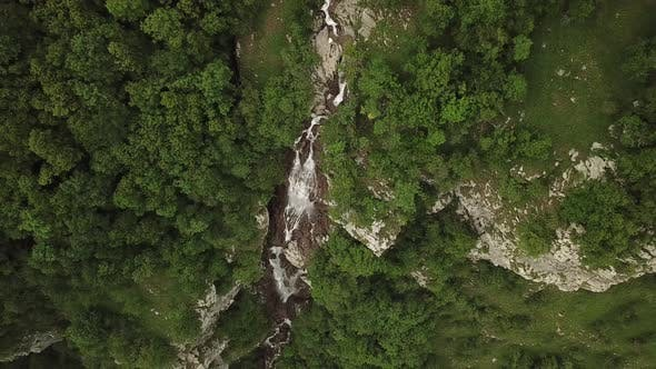 Thumbnail for Waterfall in the Forest. Aerial Nature Footage.