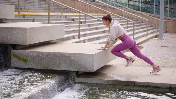 Urban Woman Doing Mountain Climber Exercise