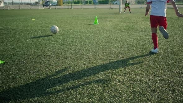 Little Footballer Is Running and Kicking Goal