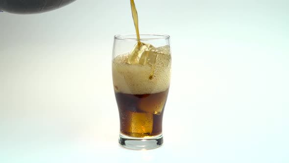 Thumbnail for Coca Cola Is Poured Into a Glass From a Bottle. White Background