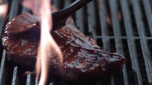 Barbeque sauce on t-bone steak, shot on Phantom Flex 4K