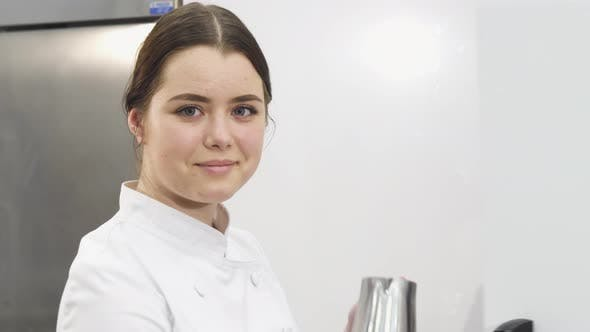 Thumbnail for Beautiful Female Chef Smiling To the Camera While Working on Her Kitchen