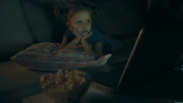 Thumbnail for Little Girl Child Home On Sofa Watching Television