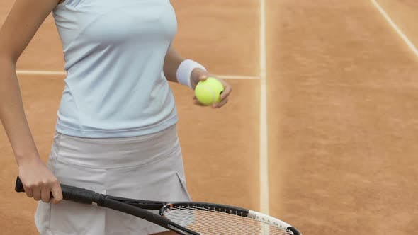 Thumbnail for Female tennis player bouncing ball on racket, healthy lifestyle and sports hobby